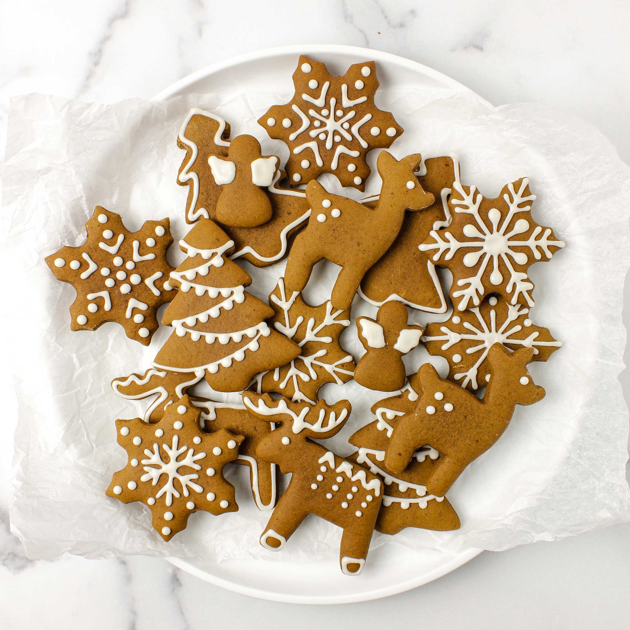 Gluten free gingerbread cookies decorated with white icing