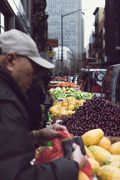 A man shops for produce in a city farmer's market