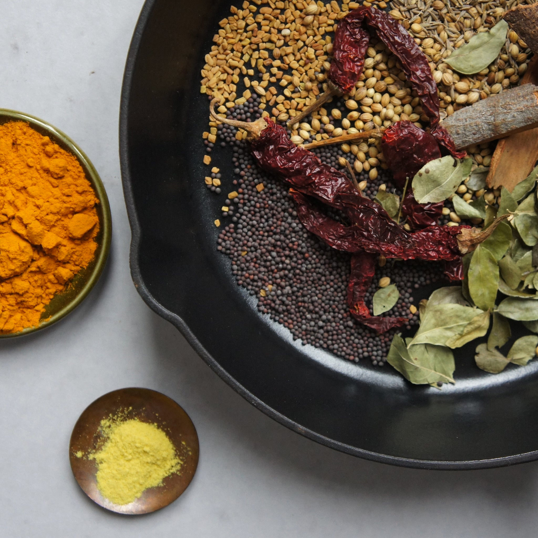 rasam spice blend in cast iron skillet