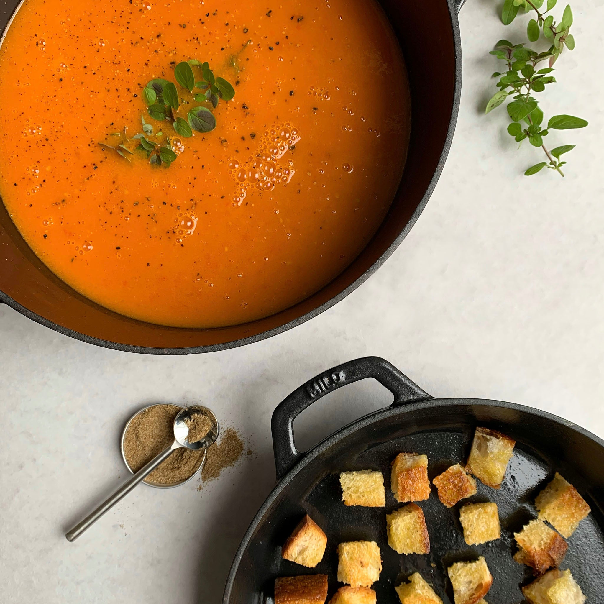 tomato soup in dutch oven with crispy croutons