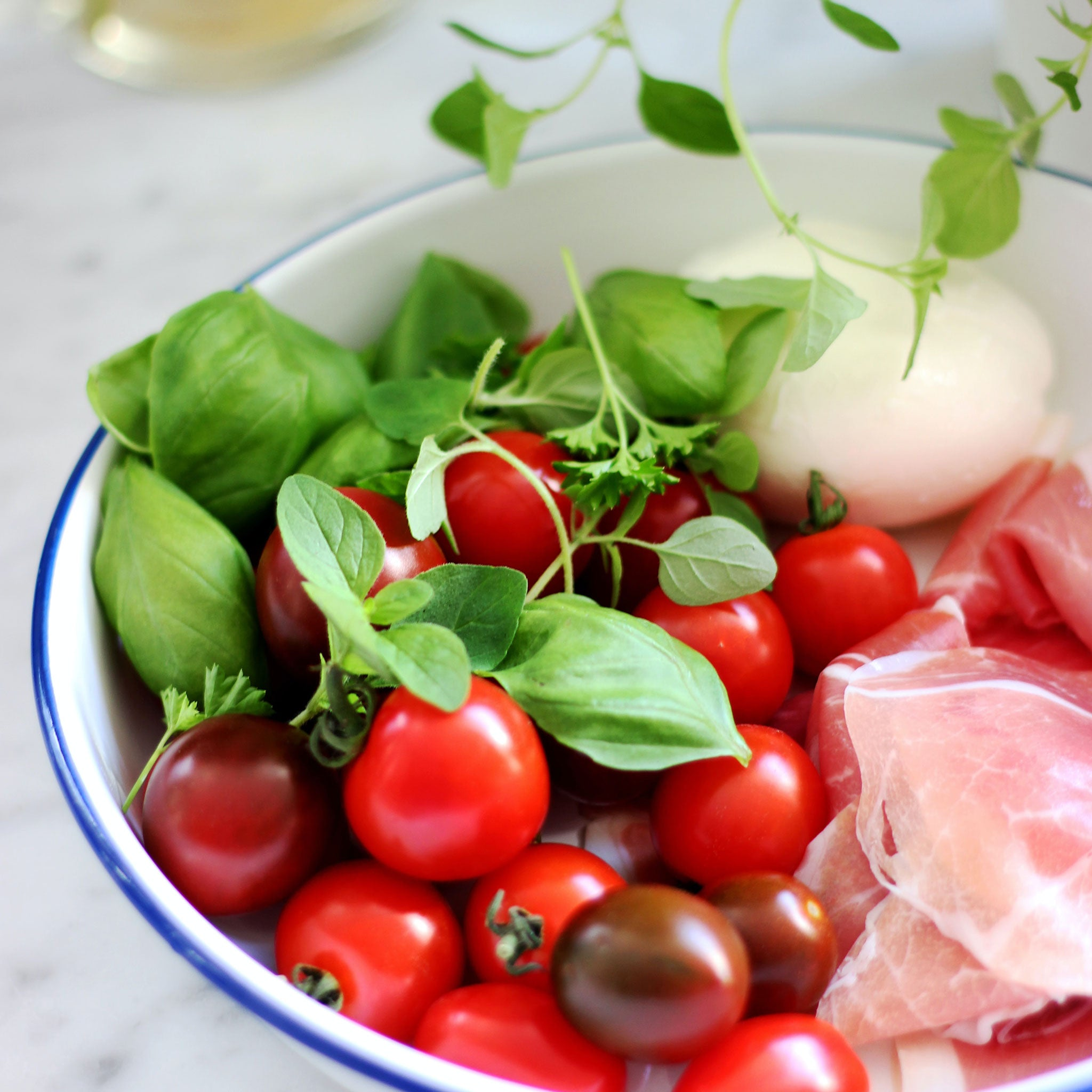 plate of antipasti with fresh herbs
