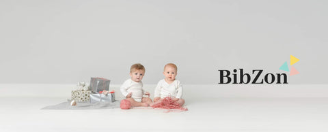two babies with gifts and bibzon brand logo