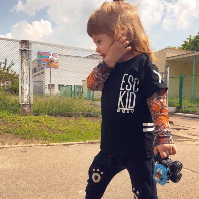 girl wearing black tattoo sleeve t shirt