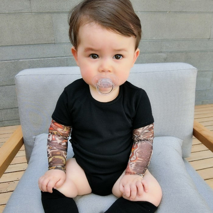 baby wearing black tattoo sleeve romper