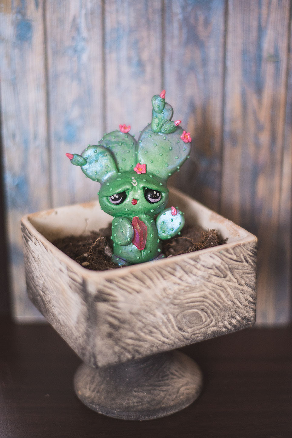 Custom hand sculpted polymer clay green cactus with pink flowers mish in pot holding pink aura quartz