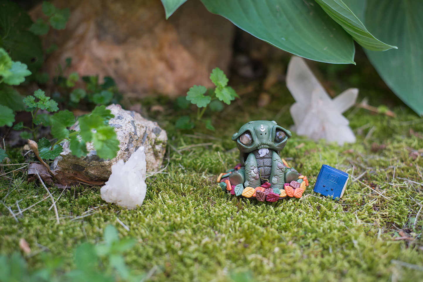 Custom hand sculpted polymer clay green tortoise mish with removable shell hiding in moss with labradorite eyes