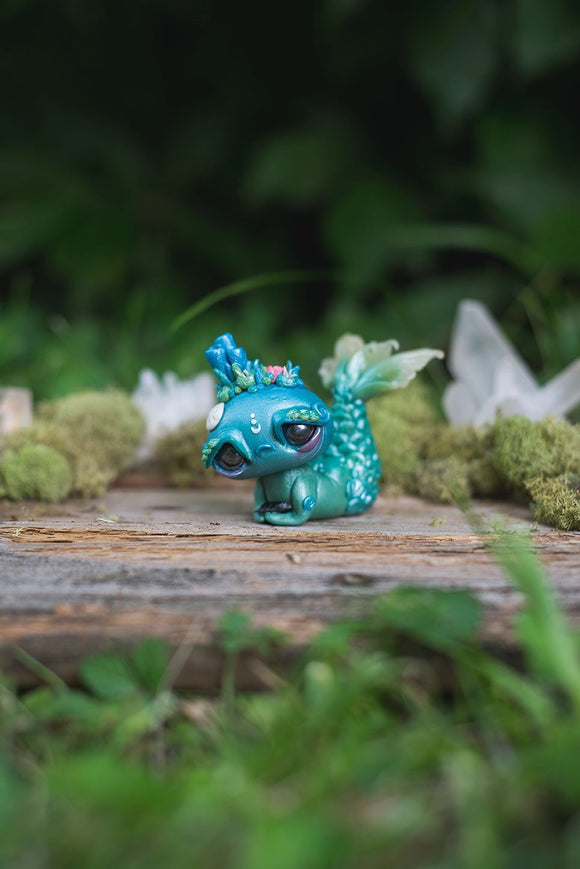 Front View of Blue & Green Mermish - handmade polymer clay mermaid creature with coral reef on head holding obsidian