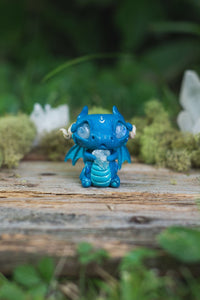 Front View of Blue Dragon Mish - handmade polymer clay dragon creature with tail and wings, holding aquamarine crystal