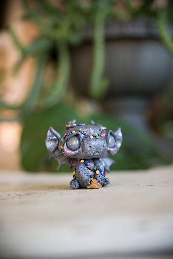 SALE! Gargoyle wearing String of lights with labradorite eyes, holding tigers eye #106