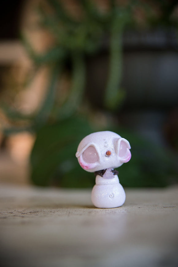 SALE! Snowmish with rose quartz eyes, holding rose quartz #98