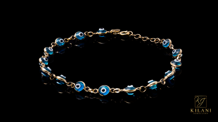 10K Yellow Gold Light Blue Eye Bracelet