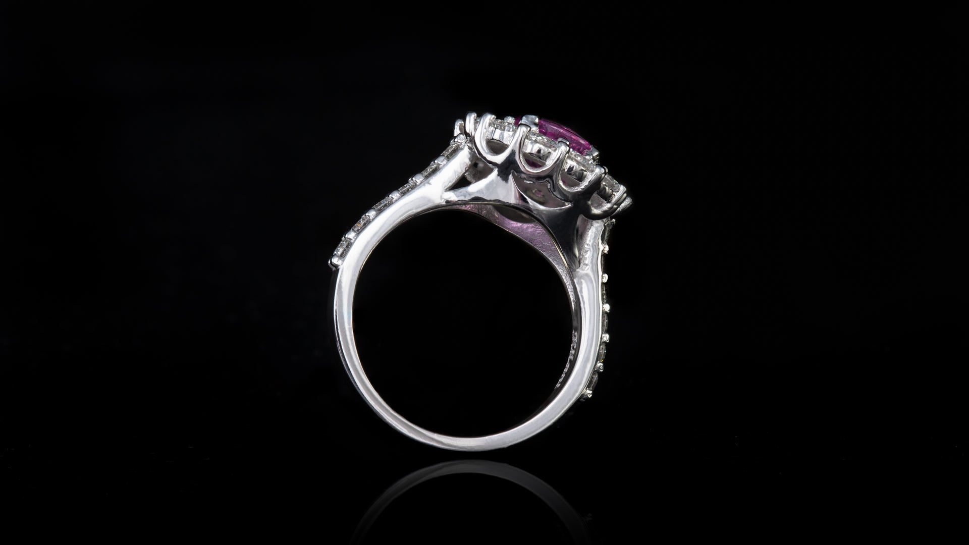 Platinum Round Pink Sapphire In Tiger Claw Engagement Ring