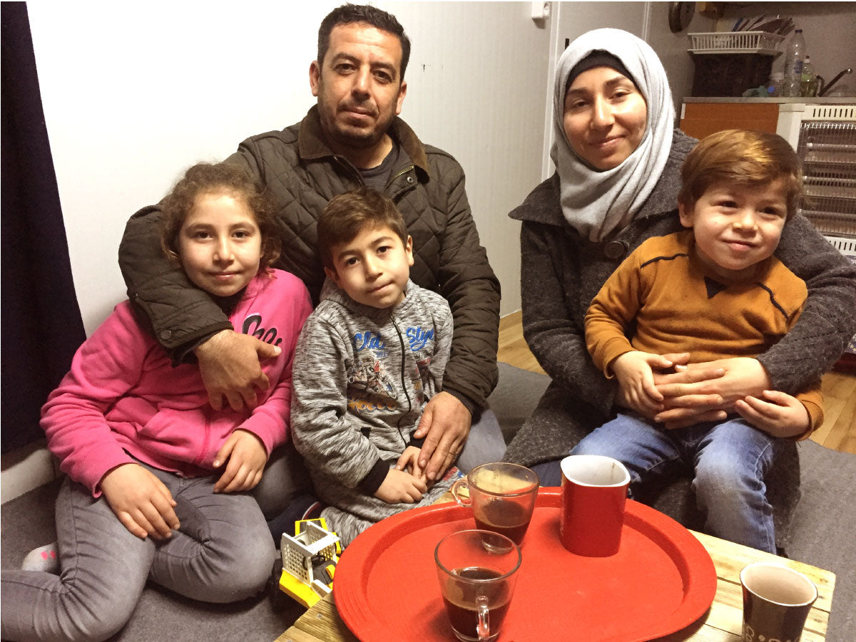 A family in a refugee camp in greece