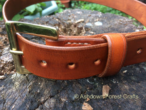 Hand sewn leather belt with a brass buckle