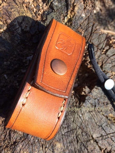 A hand-made leather belt pouch to fit the Olight S2 or S2R Baton torch.