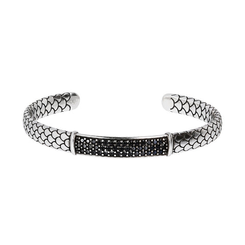 Black Spinel Bangle with a plate