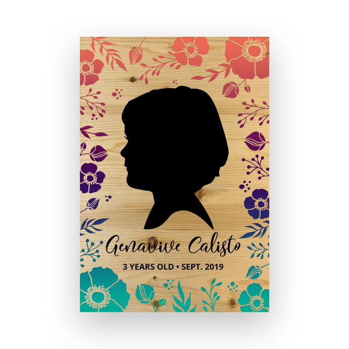 Engraved Wood Silhouette with a floral themed child silhouette cameo side profile.
