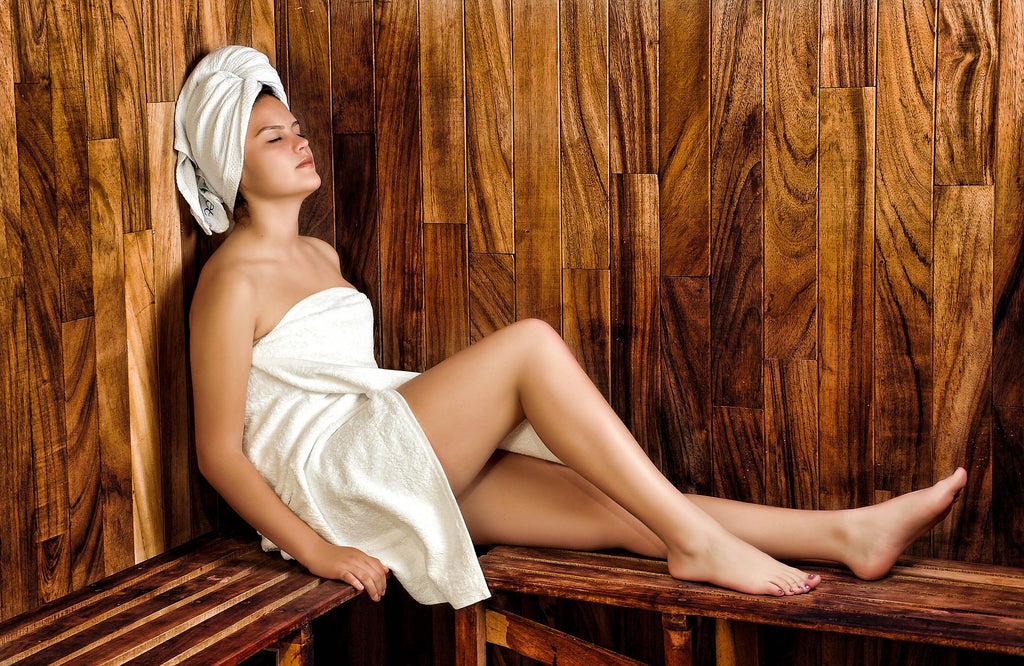 Woman doing sauna bath