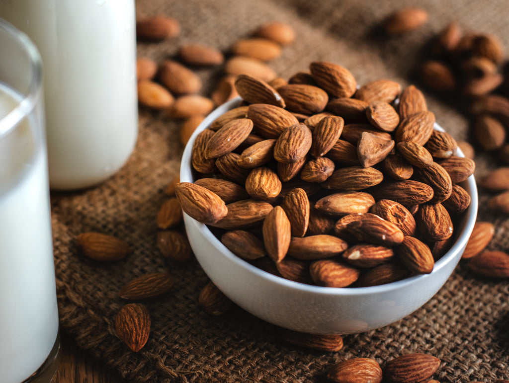 Almonds on white bowl