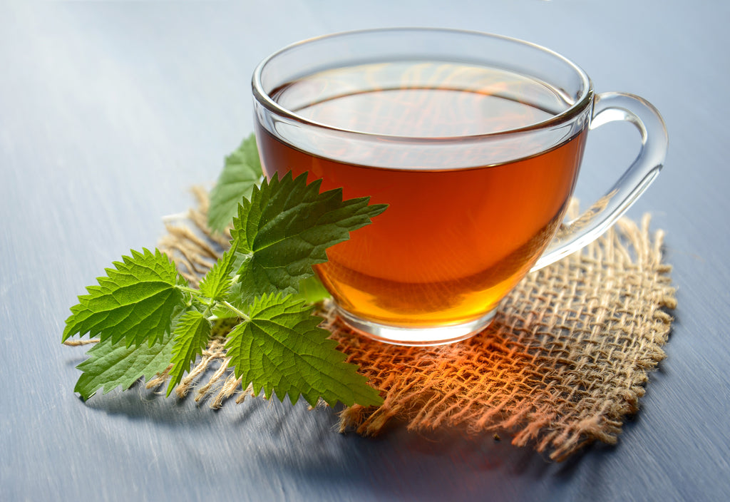 Cup of tea with peppermint leaves