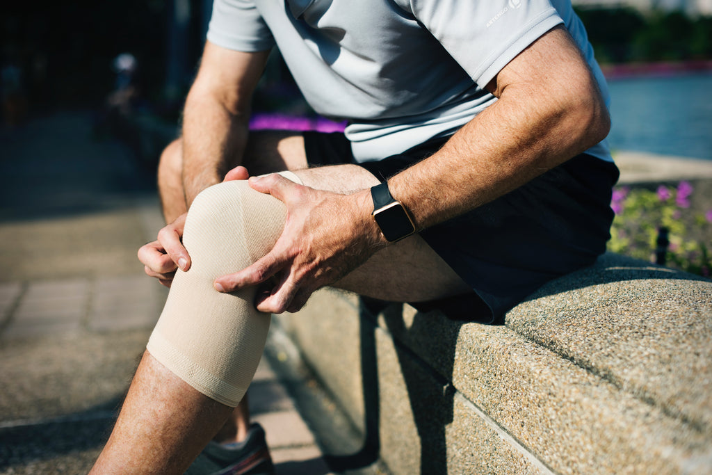 Man with bandaged knee