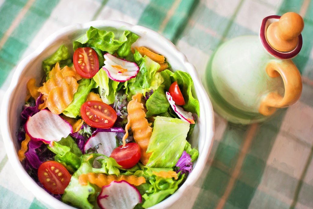 Bowl of delicious green salad