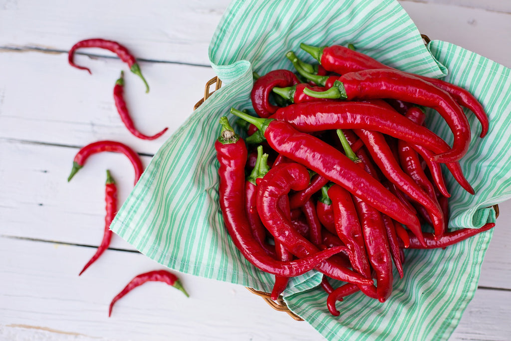 Red cayenne peppers in basket