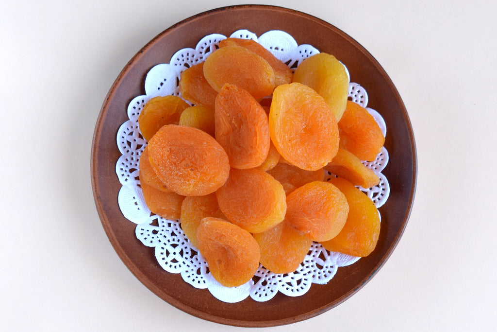 Dried apricots on plate
