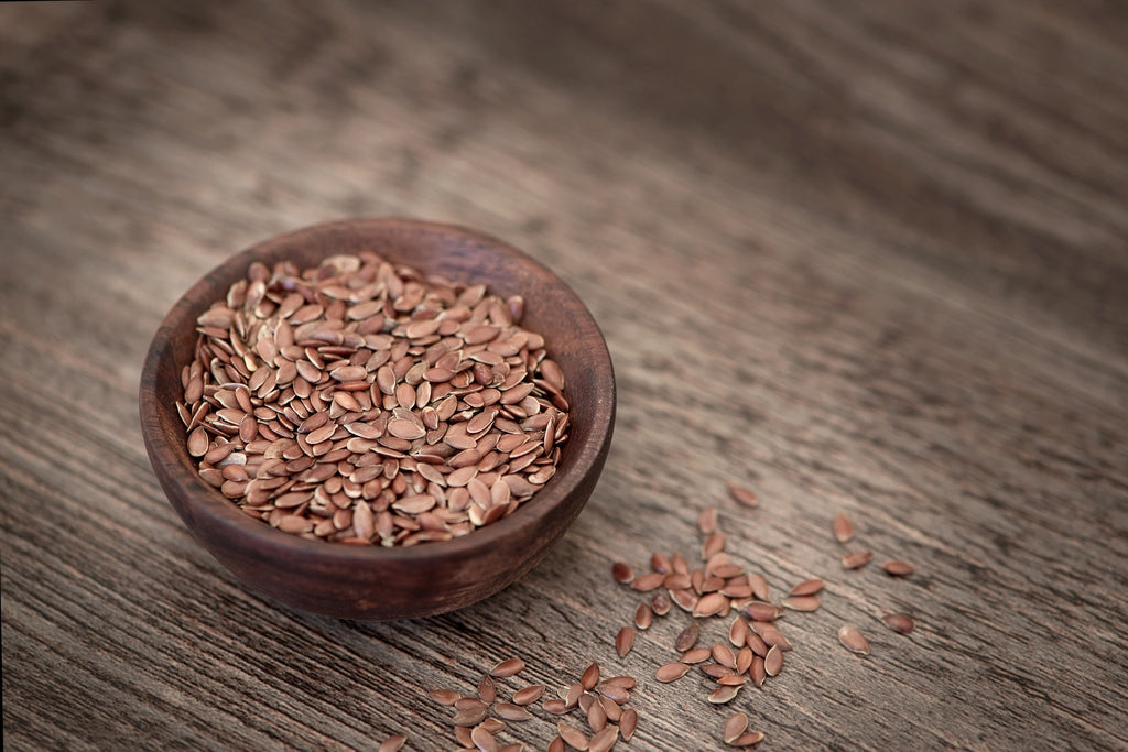 Flax seeds on wooden bowl