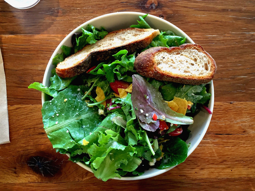 Green salad bowl with bread