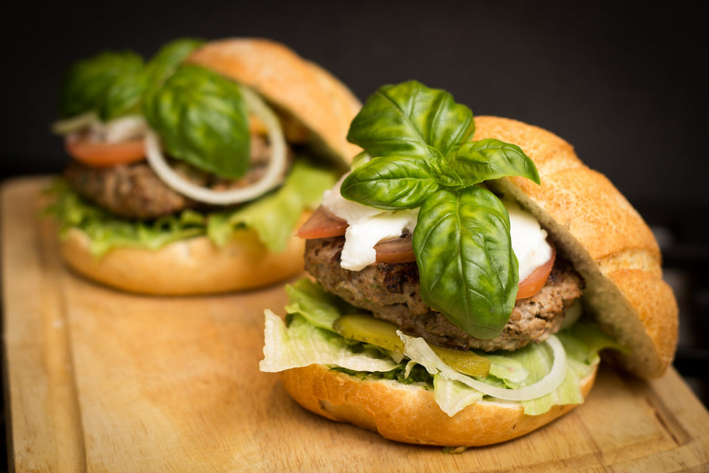 Hamburger topped with basil