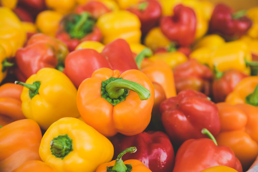 Yellow orange and red bell peppers