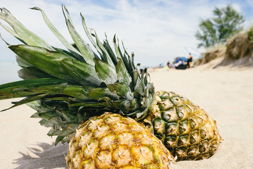 Pineapple on sand by the beach
