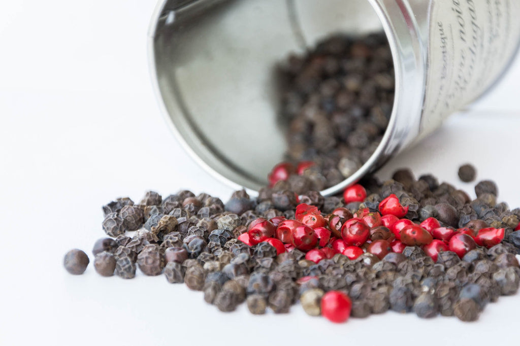 Pouring peppercorns from tin