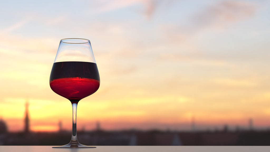 Glass of red wine and sunset