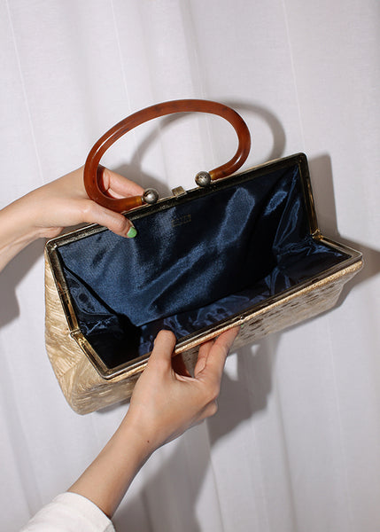 VINTAGE STRAW PURSE WITH PLASTIC HANDLE