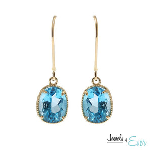 10KT Yellow Gold 9 x 7 mm Genuine Blue Topaz Earrings
