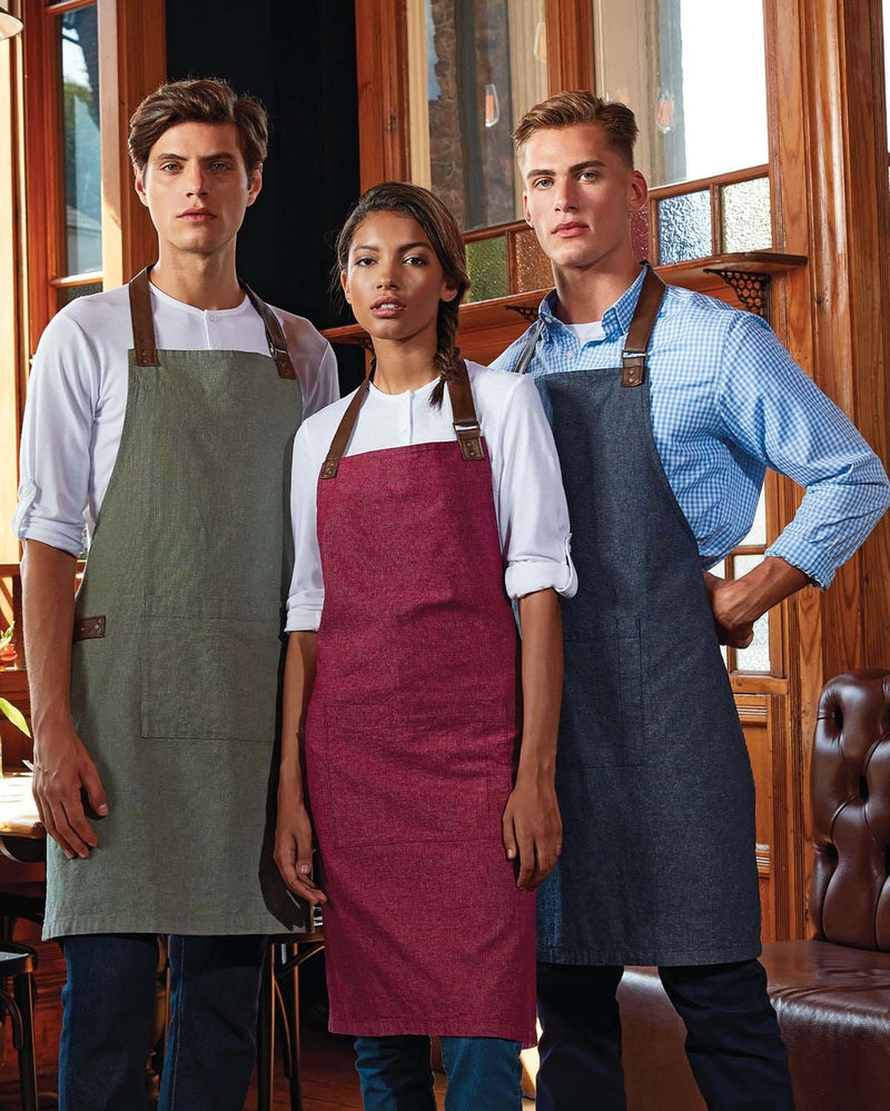 2 Men & 1 Lady in a Restaurant Wearing Different Coloured Aprons