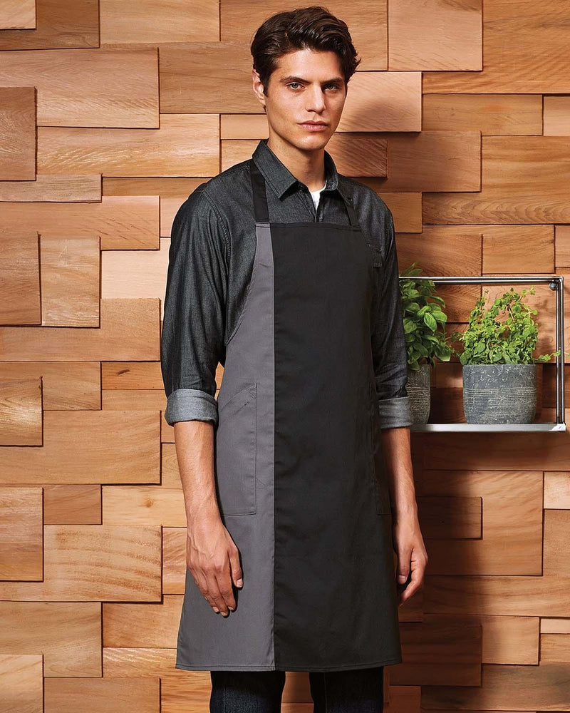 Man Wearing Black and Grey Contrast Bib Apron