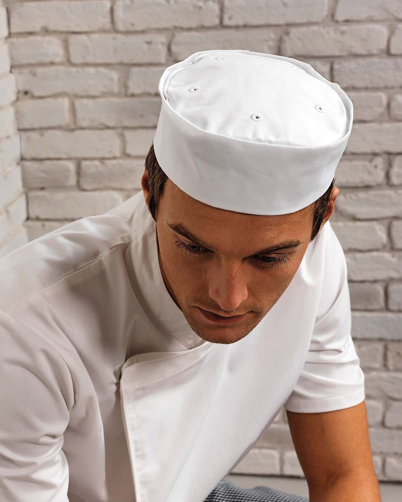 Male Chef Showing Top of Turn Up Chef Hat