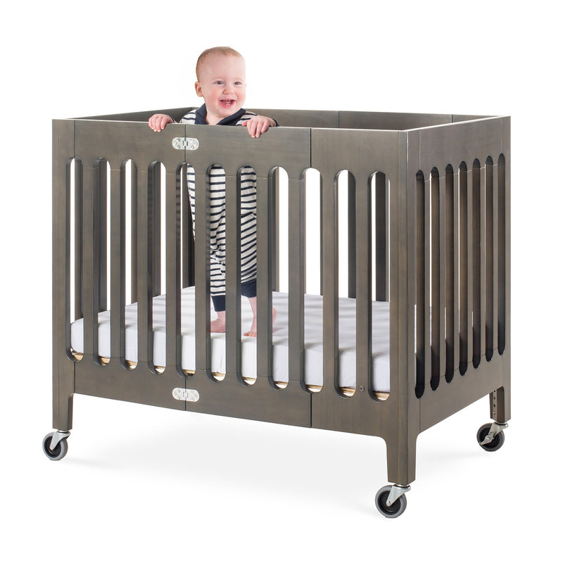 "Foundations Boutique Compact Folding Wood Crib with 3"" Foam Mattress and Oversized Casters - Dapper Gray"