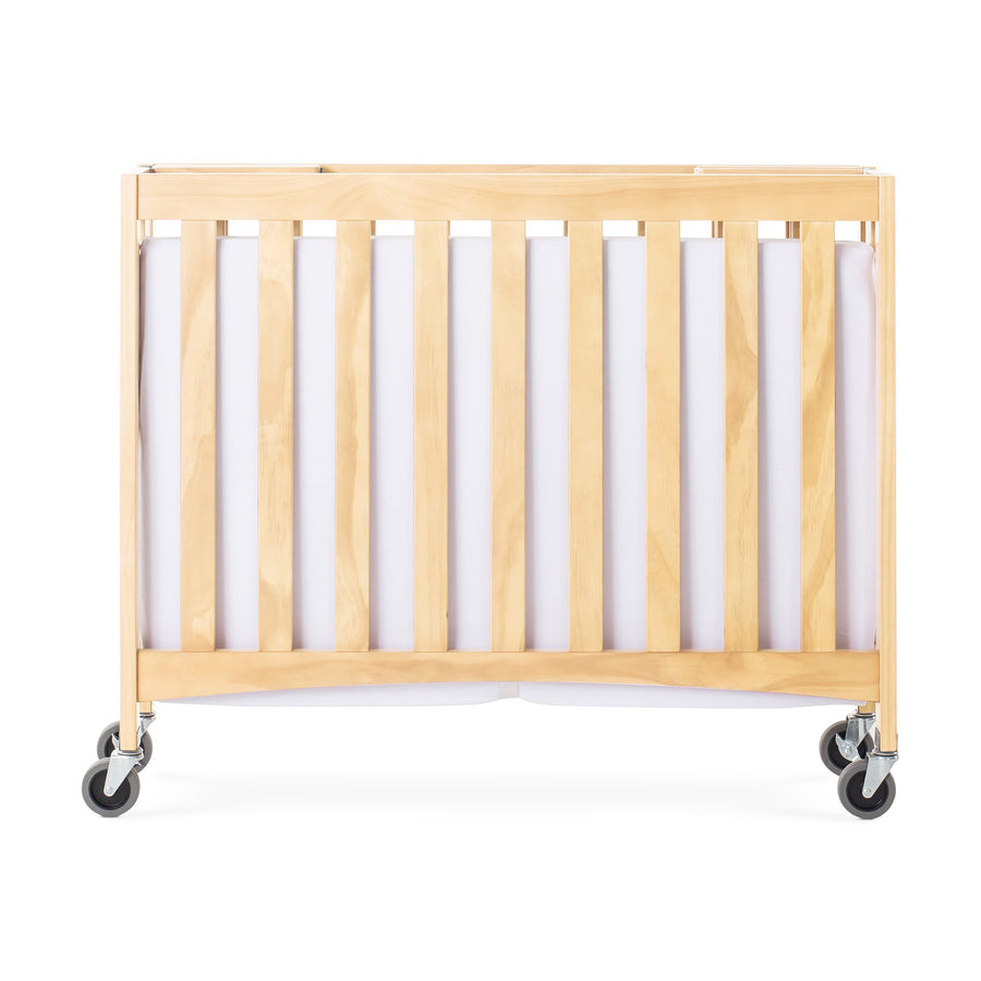 "Foundations Travel Sleeper Compact Folding Wood Crib with 2"" Foam Mattress and Oversized Casters - Natural"