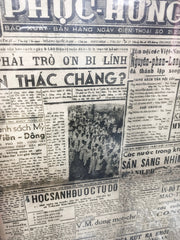 black and white travel photo Vietnamese newspaper