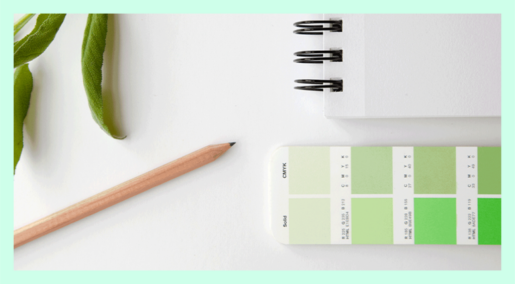 Creative Business Launch Course B Hero Image of a sketchbook, color swatches, pencil and greenery to help build your brand