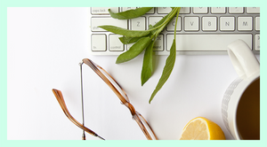 Creative Business Launch Course C Hero Image of a keyboard, glasses, tea and greenery to help build your brand