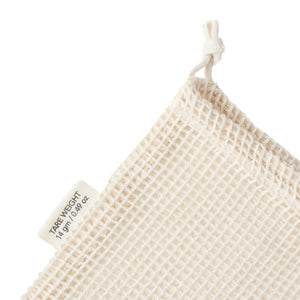 Tare weight tag on small organic cotton mesh produce bag
