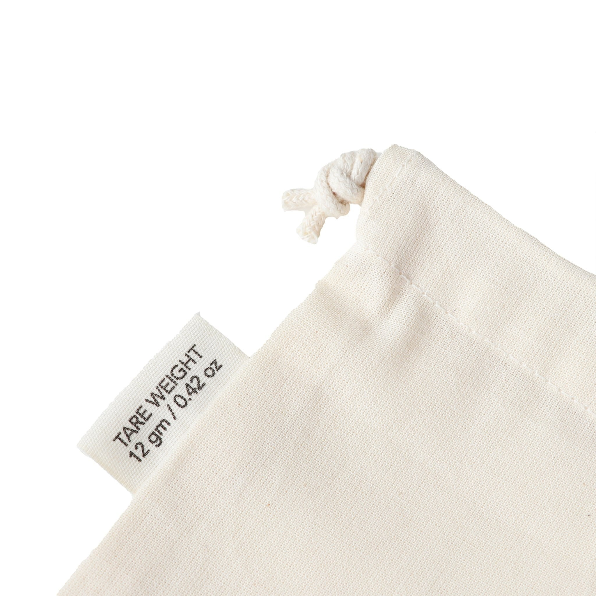 Tare weight tag on small organic cotton produce bag
