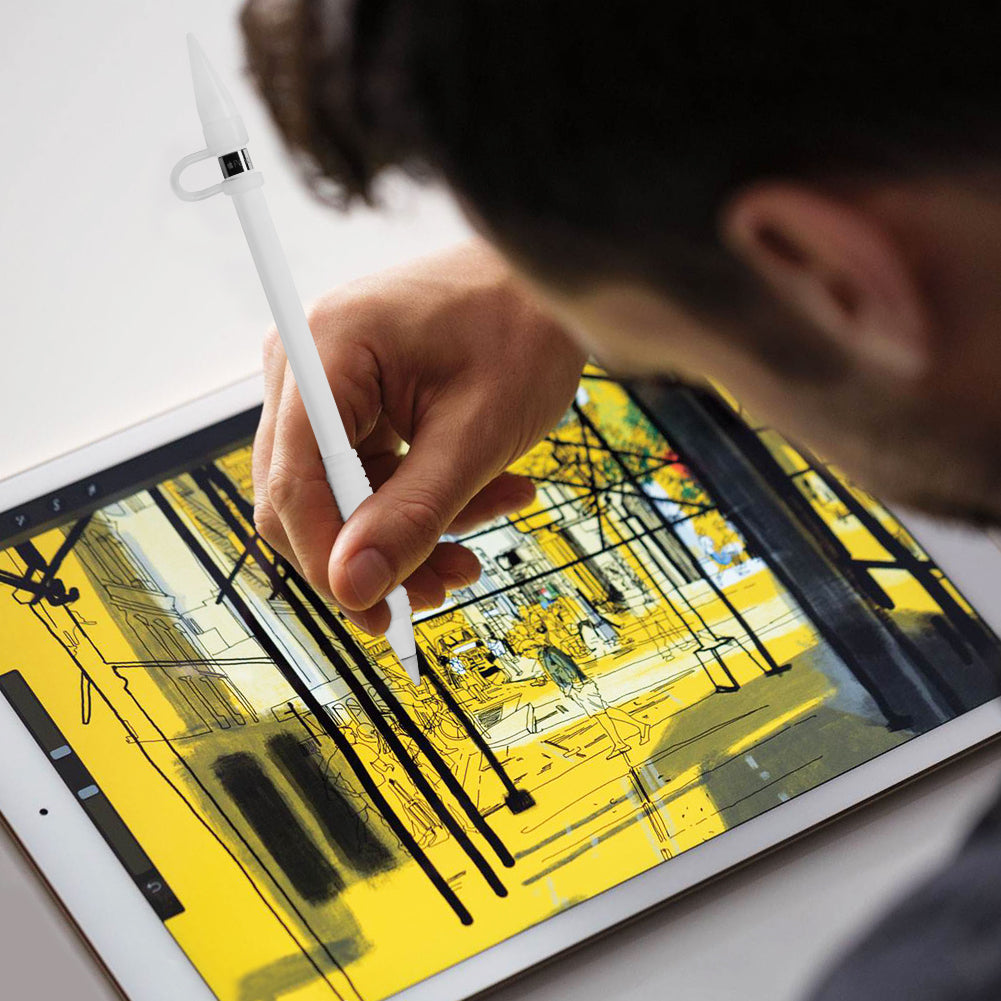 a man is drawing with apple pencil on a ipad