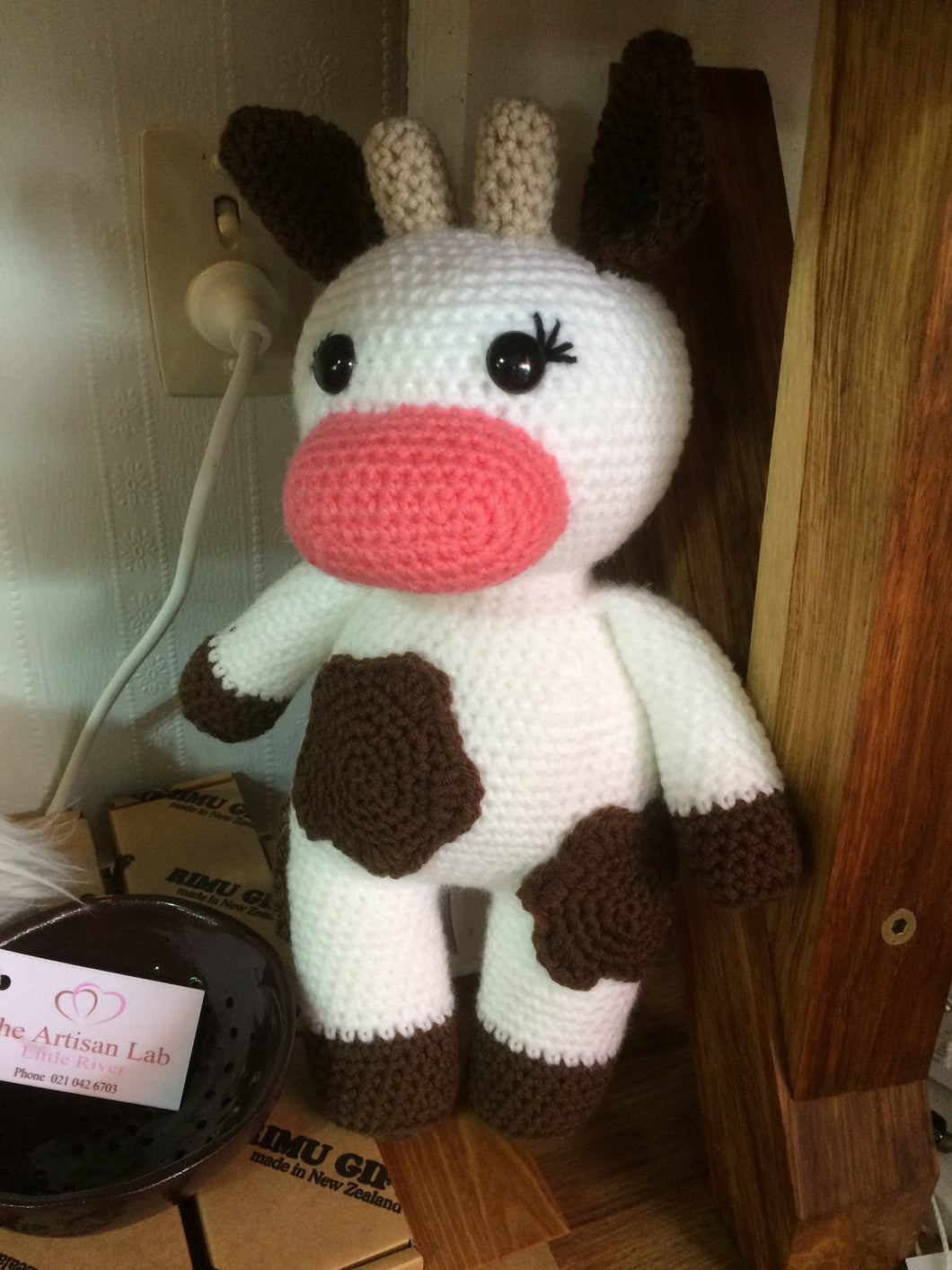 Handmade crocheted cow
