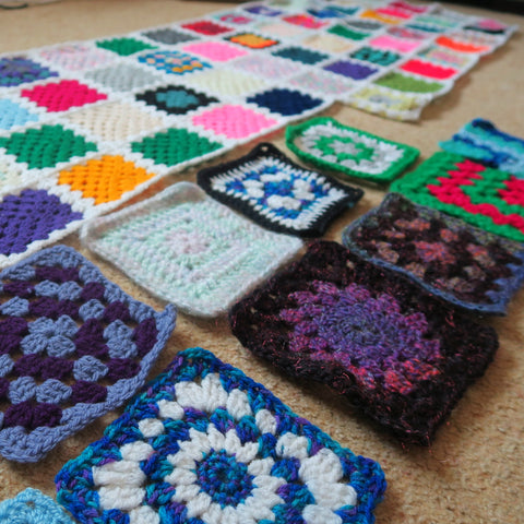 Colourful granny square blanket with random crochet squares